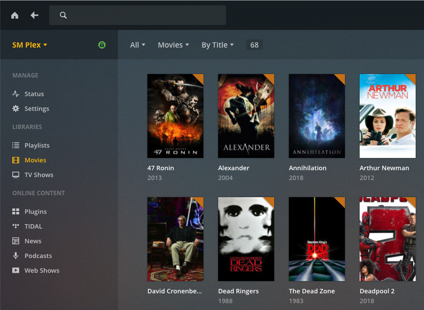 The Plex Media Server interface displays all of the movies and TV shows in a grid, with a thumbnail for each media file.